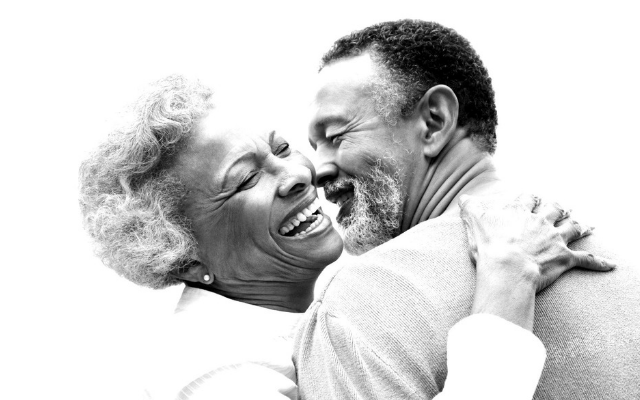 Two people embracing and laughing together