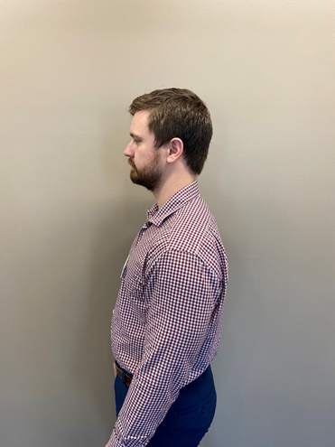Profile of person standing with good posture