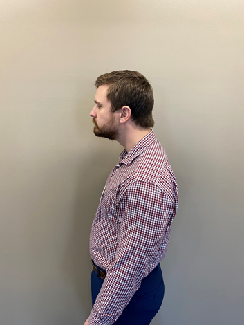 Profile of person standing with bad posture