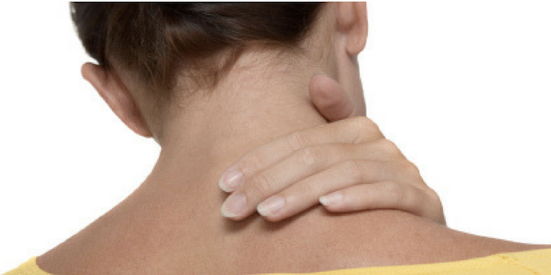Person holding neck