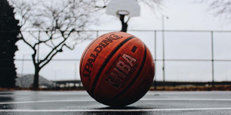 Basketball sitting on a basketball court