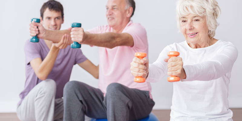 Group of people lifting hand weights
